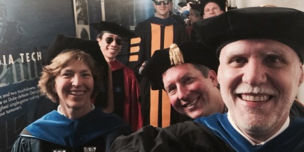Jeff Glass with faculty colleagues at commencement