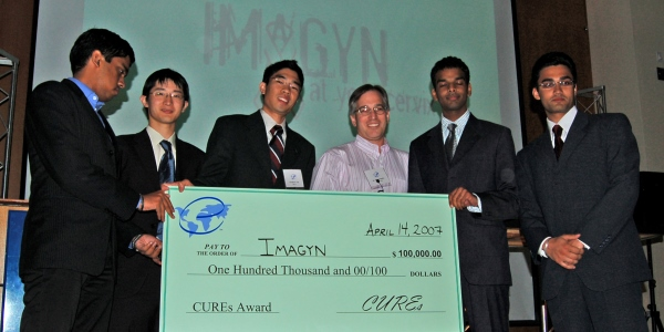 The ImaGYN team accepts a check for $100,000 in the 2007 CUREs competition. From left to right, Ram Balasubramanian, Wynn Xiao Wu, Theo Tam, Professor Bob Malkin, Adnan Haider, and Gauravjit Singh.